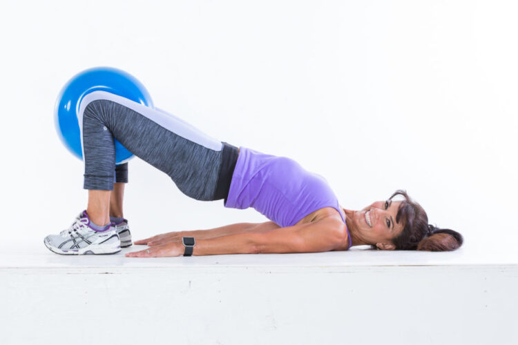 Hip thrust with inner-thigh squeeze step 1 - Body Ball Cardio